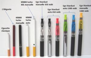Une cigarette classique à côté de quelques modèles de cigarettes électroniques
